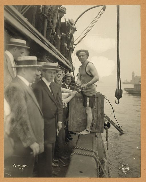 [Harry Houdini stepping into a crate that will be lowered into New York Harbor as part of an escape stunt on July 7, 1912] / Dietz N.Y.