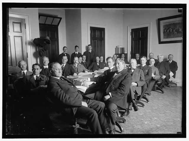 HOUSE OF REPRESENTATIVES COMMITTEES, AGRICULTURE. IN FRONT OF TABLE: REPS. LEVER OF SC, CHAIRMAN; GORDON LEE OF GA; YOUNG OF TX; HEFLIN OF AL; LESHER OF PA; DOOLITTLE OF KS; UNIDENTIFIED; HAUGEN OF IA; UNIDENTIFIED. AT REAR OF TABLE: CANDLER OF MS; EXTRA LEFT; RUBEY OF MO; JACOWAY OF AR.; M.K. REILLY OF WI
