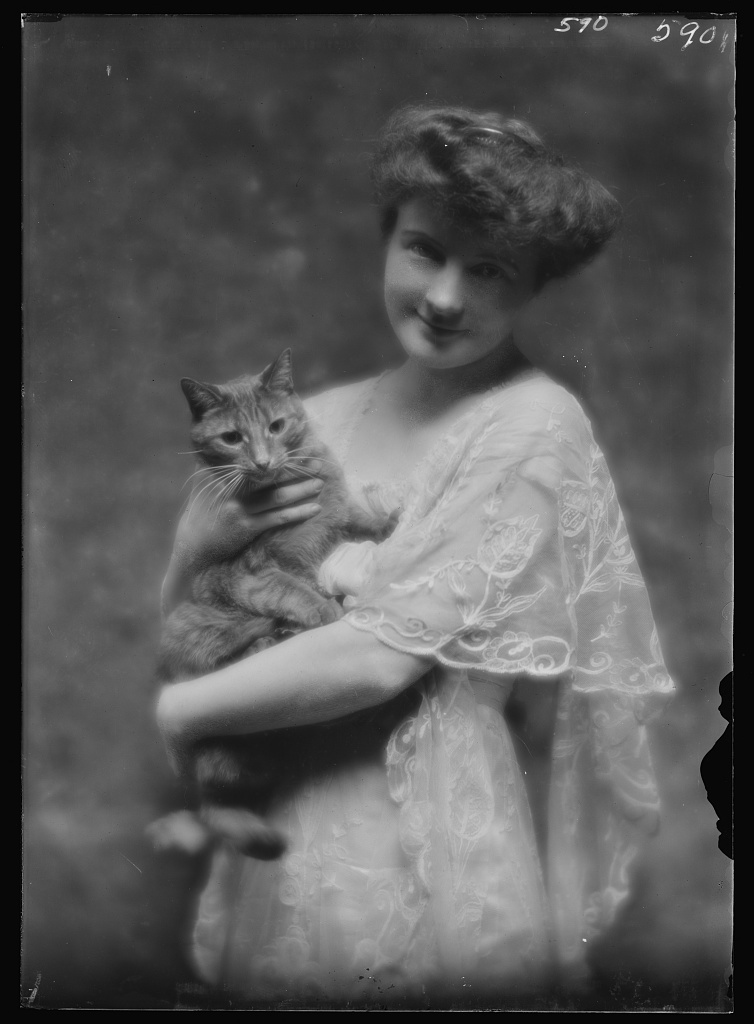 King, G., Miss, with Buzzer the cat, portrait photograph