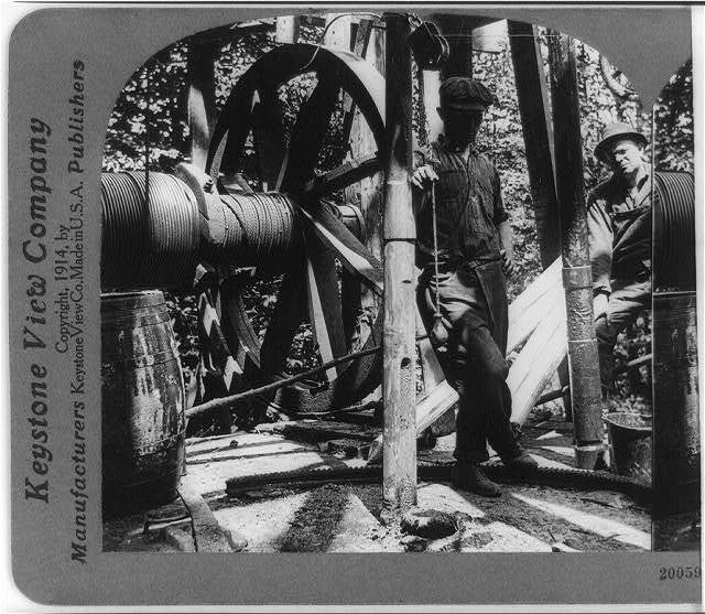 Letting down steel tape into well to locate position of shell-- oil field in Penn'a, U.S.A.
