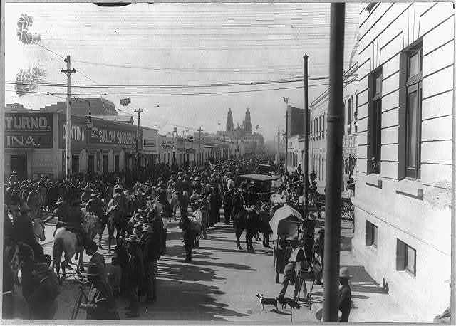 [Mexican War, 1914: Rebel troops passing through street in Chihuahua]