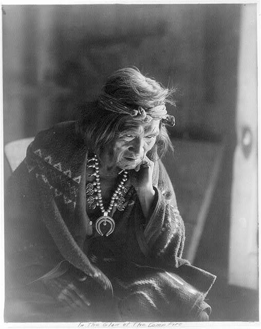 [Navaho Indians: In the glow of the camp fire (old man)]