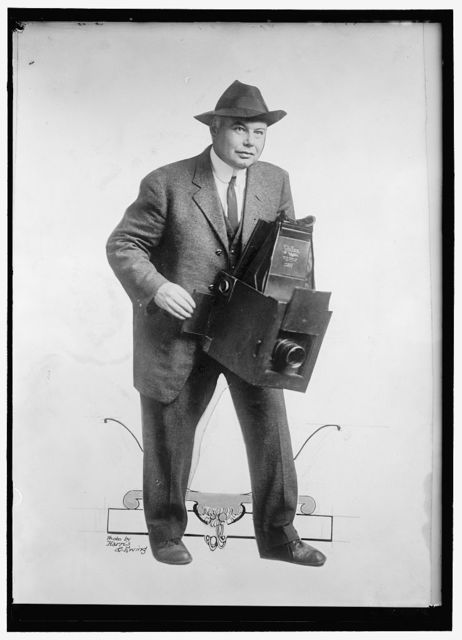PHOTOGRAPHER WITH LARGE FORMAT CAMERA
