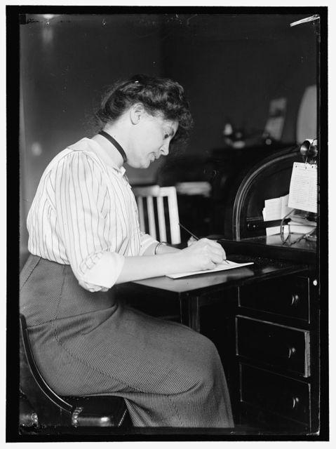 SHELDON, MISS CAROLYN B. AT DESK