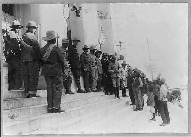 Side view of Gen. Villa, Gov. Chao and staff on steps of Federal Palace, Chihuahua, Mexico