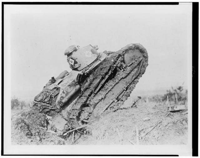 [Tank ploughing its way through a trench and starting toward the German line, during World War I, near Saint Michel, France]