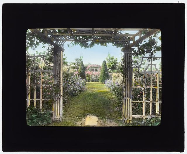 "[""The Fens,"" Lorenzo Easton Woodhouse house, Huntting Lane, East Hampton, New York. Pathway from pergola]"