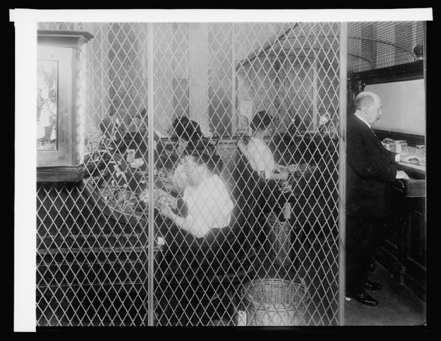 Treasury Dept., Ofc. of U.S. Treasuer money counters, Cash room: checking and assorting daily deposits, [1914]