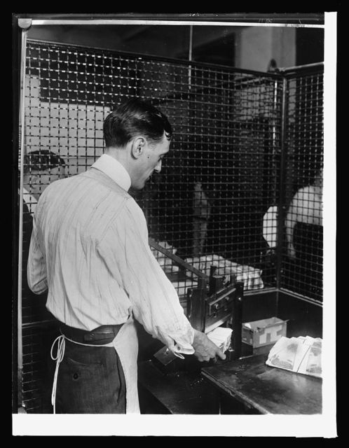 Treasury Dept. Ofc. of U.S. Treasuer, Redemption Agency: first step in distruction of national bank notes. Lower corner of each end being cut off, [1914]