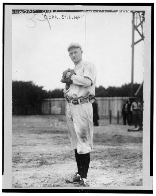 [William Leopold Doak, St. Louis Cardinals baseball player, full-length portrait, facing front, standing, wearing uniform, about to pitch baseball]