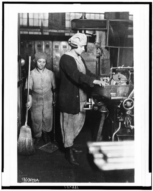 [Woman grinding small gear cutter, and woman sweeping at Midvale Steel & Ordnance Co., Nicetown, Pa., during World War I]