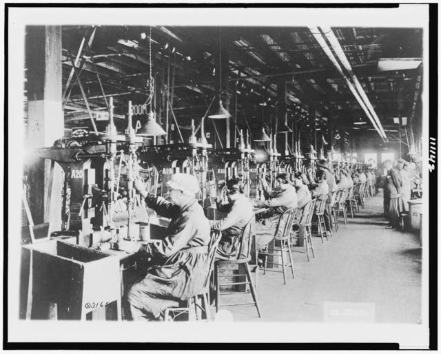 [Women operating drill presses for reaming out holes in hand grenade bodies, Gorham Mfg. Co., Providence, R.I.]