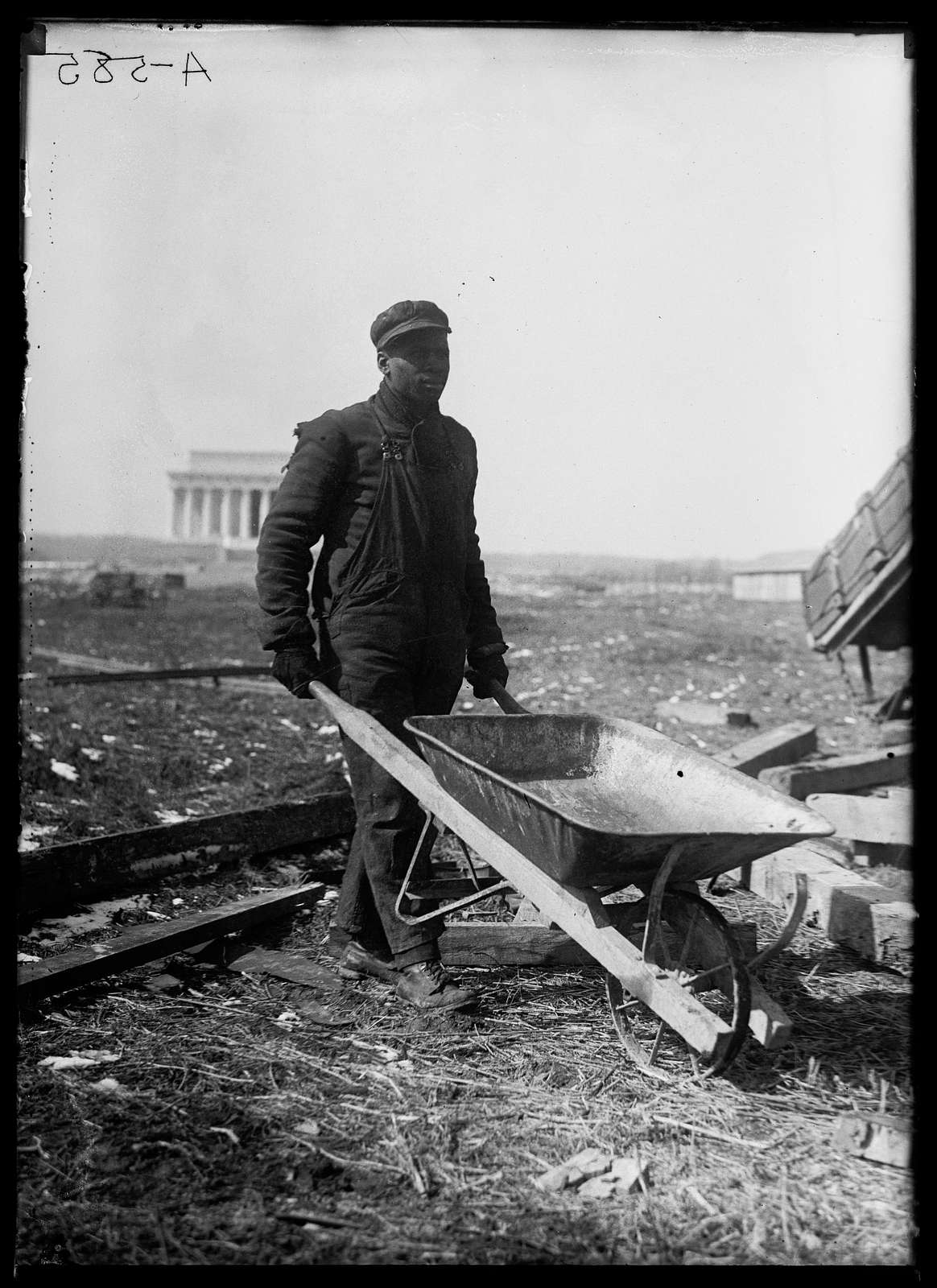 African-American laborer with Lincoln Memorial in background. Washington, D.C.