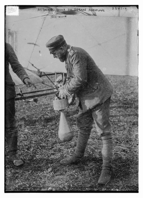 Attaching bomb to German Aeroplane