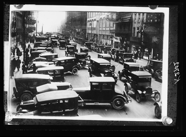 [Automobile traffic in city street]