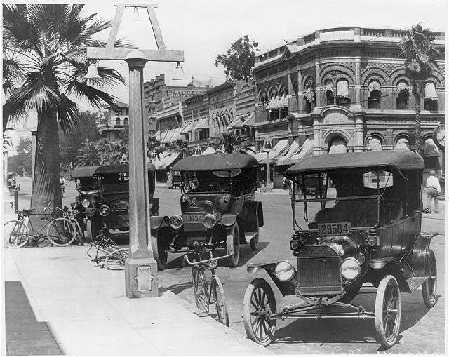 [Automobiles and bicycles parked along Riverside Ave., Riverside, California