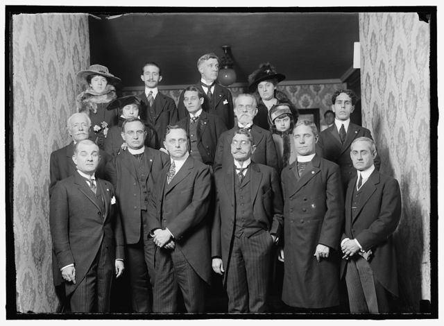 BARRETT, JOHN. DIRECTOR GENERAL, PAN AMERICAN UNION, 1907-1920. UNIDENTIFIED GROUP ON ENTRANCE STAIRWAY OF HIS RESIDENCE; 12 MEN, 3 WOMEN, CHILD