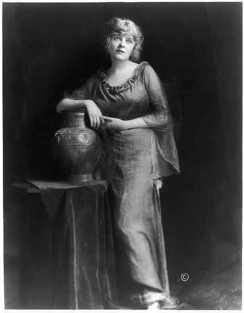 [Blanche Sweet, full length, standing, right arm on vase, facing slightly right]