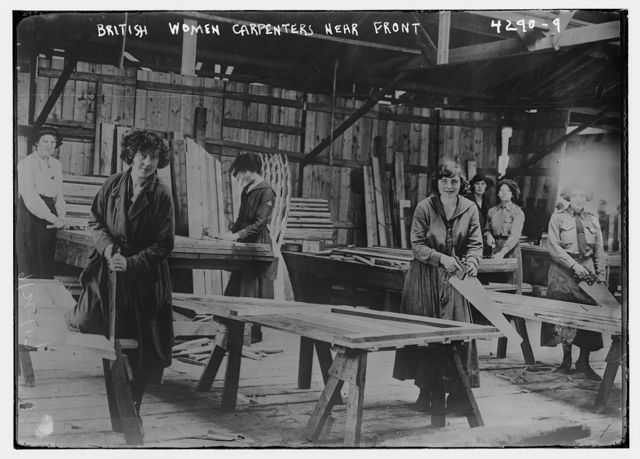 British women carpenters near front