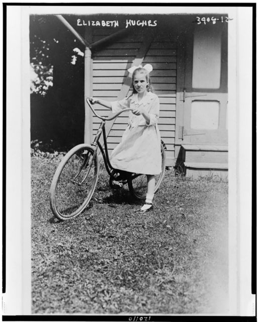 [Elizabeth Hughes, full-length portrait, standing, facing front, holding bicycle]