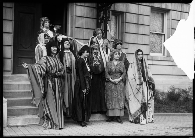 """[Group in costume on steps; sign: """"League of American Pen Women, Authors' Carnival and Ball ... Book Fair ... Massachusetts Ave. [Washington, D.C.]"""