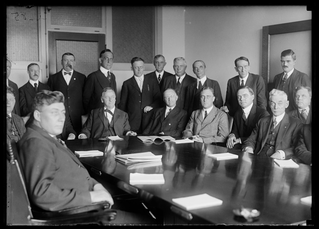 [Group includes Josephus Daniels at head of table; and Franklin D. Roosevelt]
