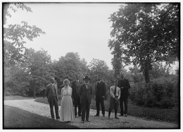 [Group picture of Orville Wright, Bishop Milton Wright, Katharine Wright, Earl N. Findley, nephew Horace Wright, John R. McMahon, and Pliny Williamson, on the walk of Orville's home, Hawthorn Hill; Dayton, Ohio]
