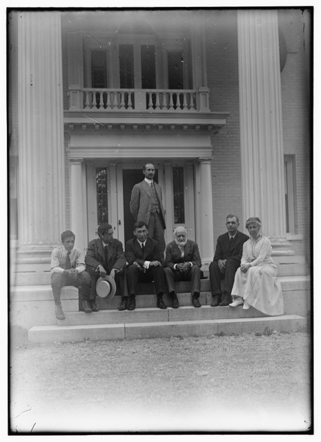 [Group picture of Orville Wright, Bishop Milton Wright, Katharine Wright, Earl N. Findley, nephew Horace Wright, John R. McMahon, and Pliny Williamson, on the steps of Orville's home, Hawthorn Hill; Dayton, Ohio]