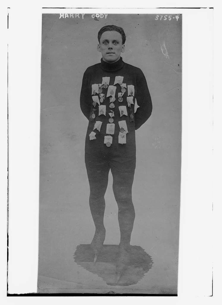 Harry Cody with sports medals