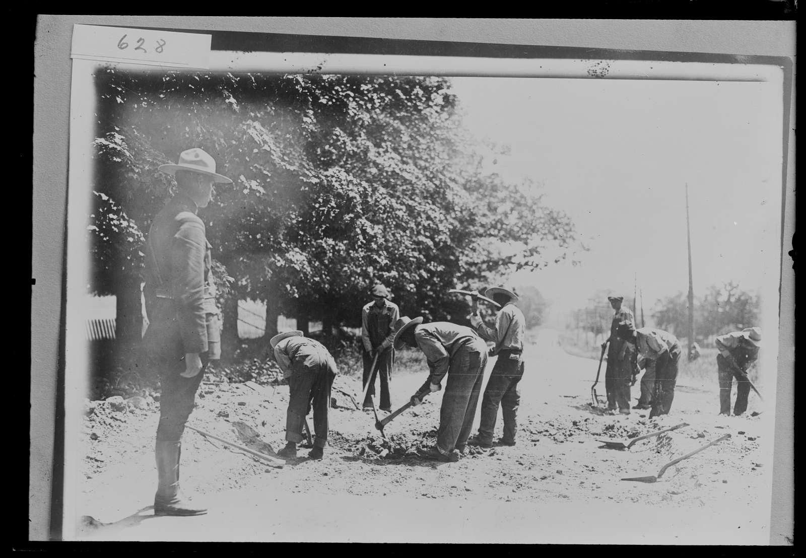 Highway construction crew, probably Michigan State Highway Dept., digging, Michigan