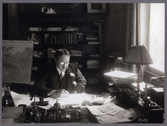 [James W. Gerard, American Ambassador to Germany, half-length portrait, seated at his desk in embassy]