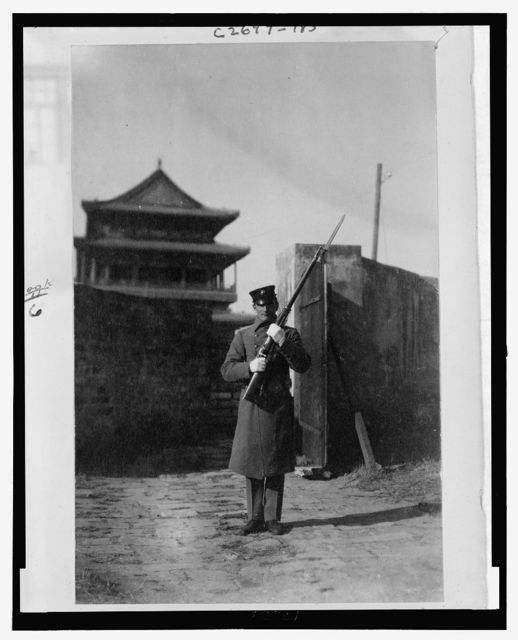 Legation guard on wall of Peking