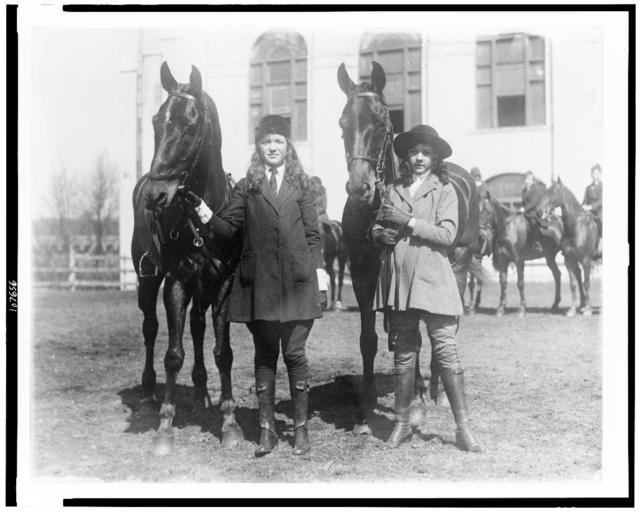 [Lucy Leffingwell, daughter of Russell C. Leffingwell, and Carolyn Chamberlain, daughter of General J.C. Chamberlain, posed with their horses, probably in New York City area]