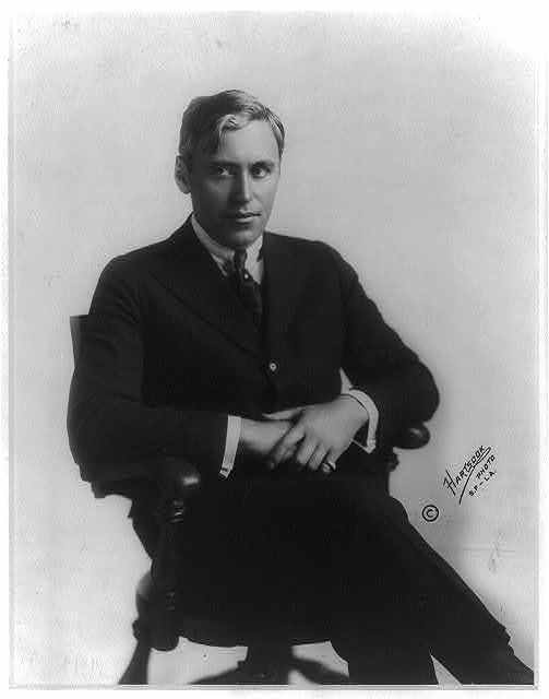 [Mack Sennett, 1880-1960, three-quarters length, seated in chair, facing slightly right]