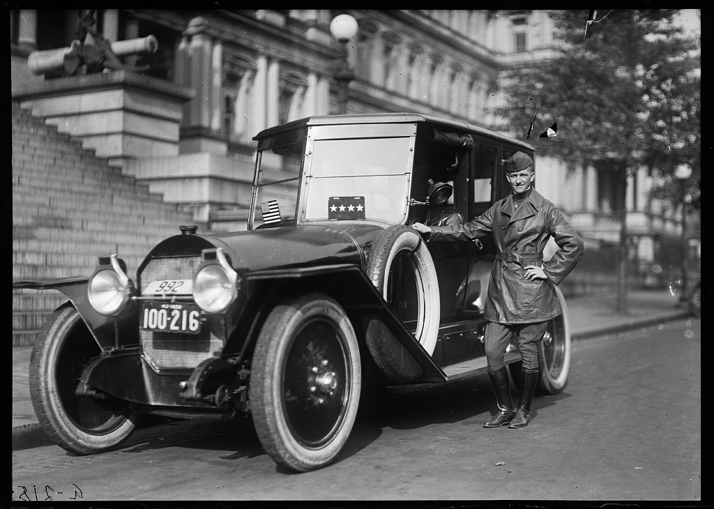 [Man with automobile in front of State, War and Navy Building, Washington, D.C.]