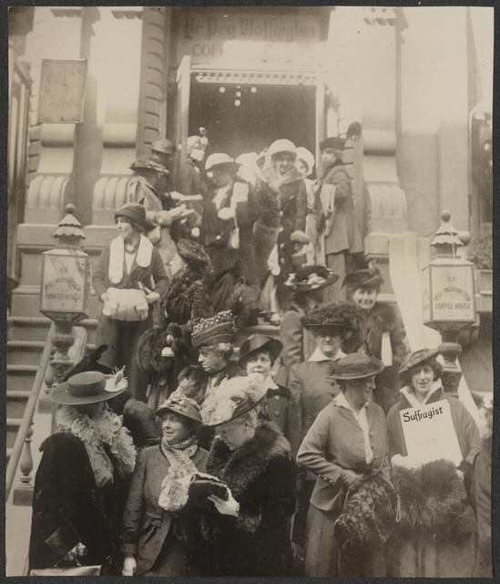 Meeting at Coffee House, New York. Front row - L-R Mrs. Wm Colt, N.Y., Mrs. Wm Kent, Cal., Mrs. John Rogers, N.Y., Lucy Burns (back of Mrs. Rogers), N.Y., Miss Hazel MacKaye, Mass. (with Suffragist)