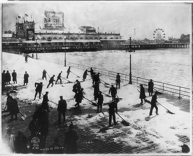 [Men clearing snow off boardwalk, Atlantic City, N.J., on Easter Sunday; Steeplechase Pier in backgrd.]