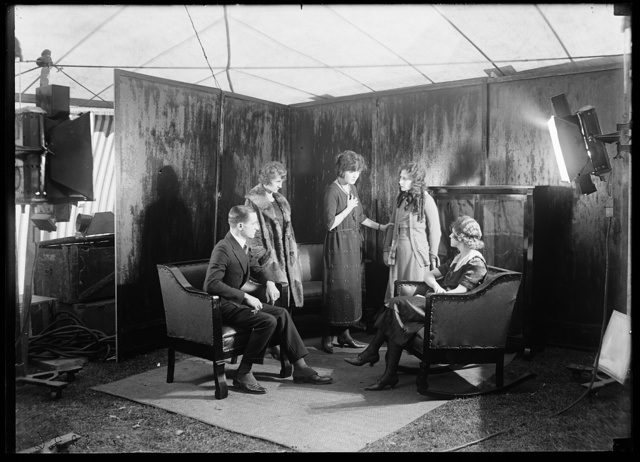 [Motion picture set: actors and actresses; Lillian Gish? 2nd from right]
