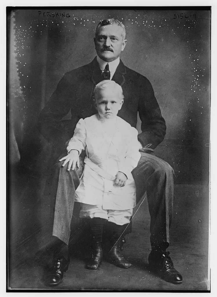 Pershing with son