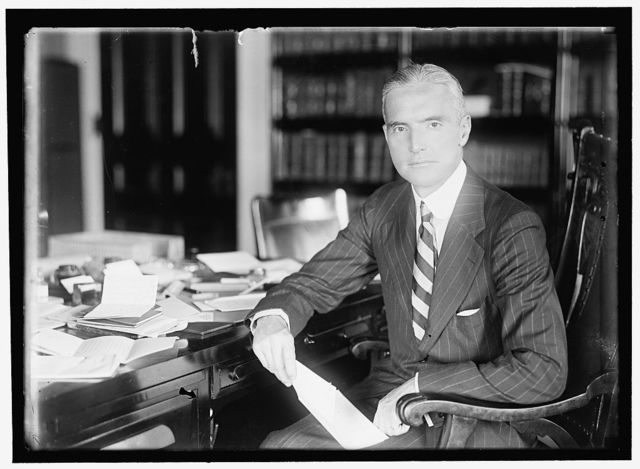 POLK, FRANK LYON, COUNSELOR, STATE DEPT., 1915; ACTING SEC. OF STATE, 1918-1919; UNDER SECRETARY OF STATE, 1920-1921. AT DESK