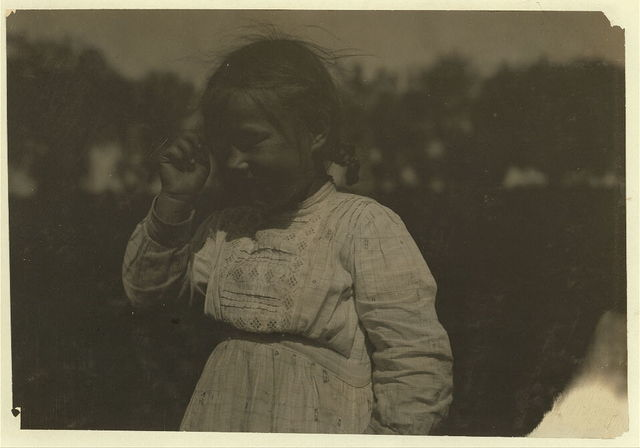 """Six-year old Tildy helps a little in the beet work, on a Colorado farm near Rocky Ford. Her father is German. He said: """"I don't work my children until they are older."""" Another German farmer nearby said the same. Another father said: """"Americans don't work their kids the way foreignors [i.e., foreigners] do."""" See Hine Report, Colorado Beet Workers, July 1915.  Location: Rocky Ford [vicinity], Colorado."""