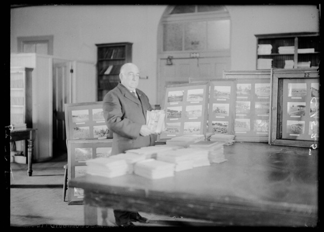 Solomon D. Butcher working on his collection at the Nebraska State Historical Society, Lincoln, Nebraska.