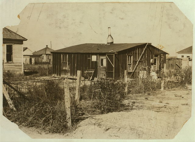 "[Some of the shacks in ""St. Petersburg,"" the district in which the beet-workers live in Sterling. Some have to rent even these poor shacks, but many have their own cottages and some buy their farms in a few years].  Location: [Sterling, Colorado] / [Photo by Hine, Oct. 21/15]"