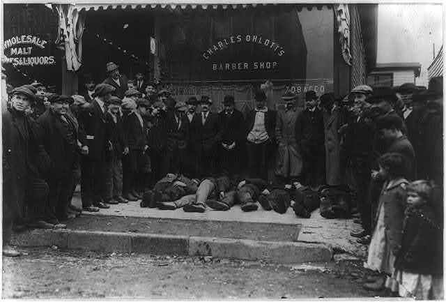 Strikers at Roosevelt. Wounded awaiting ambulance