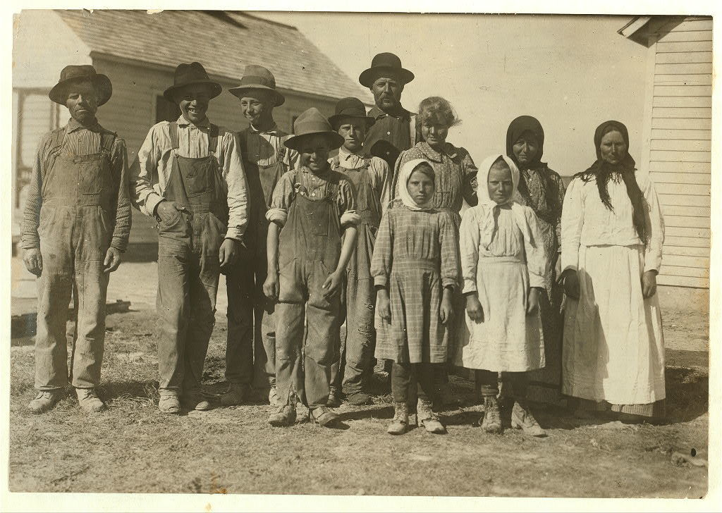 """The 8 and 10 yr. old children here are working beets on a farm near Sterling, Colo, from 5:00 A.M. to 7:00 P.M. on rush days. Father said, """"We have to get done.""""  Location: Sterling [vicinity], Colorado / Photo by Hine. Oct. 22/15."""
