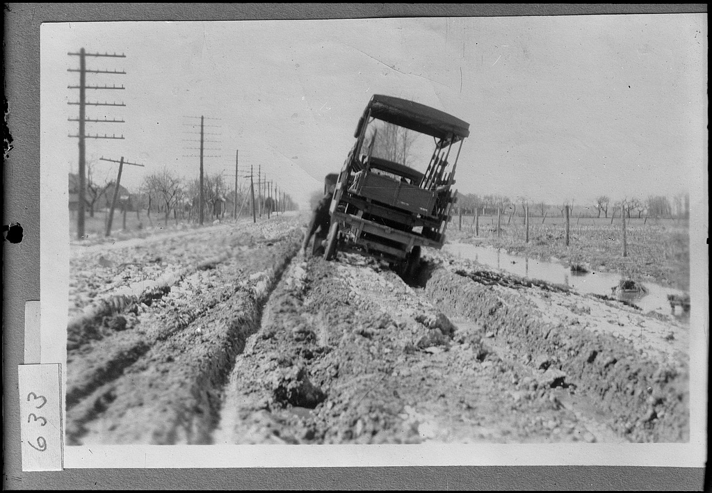 [Truck in rutted road, possibly road construction in Michigan]