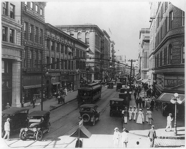 [Va. - Norfolk - Granby Street from corner of City Hall Avenue; busy street scene with autos and electric trolleys]