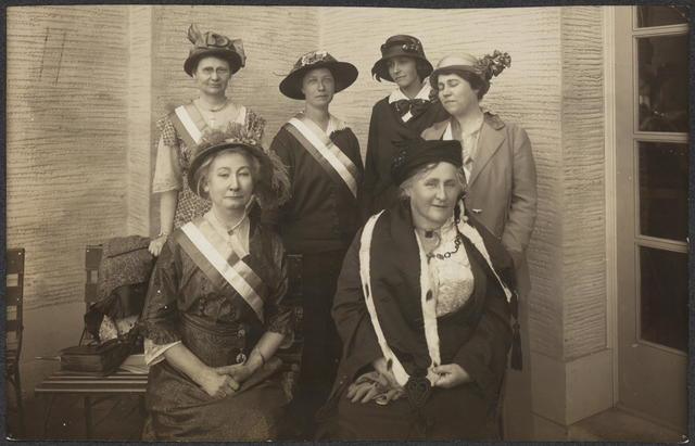 Woman's Party Booth at San Francisco Exposition Spring 1915. L-R, Front - 1 Mrs. May Wright Sewall, 2 Mrs. Kate Waller Barrett (Alexandria, Va), Rear - 3 Miss Anita Whitney (Cal.), 4 Mrs. Mary Bear, 5 Miss Vivian Pierce, 6 Miss Margaret Whittemore