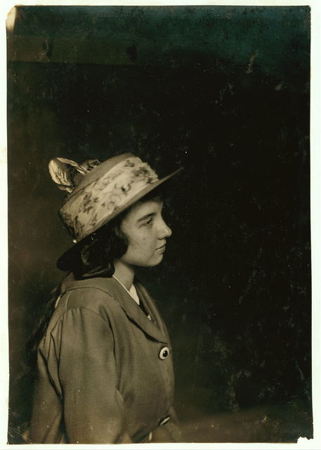 [Aldea Balanger - French - Weaver. Cornell Mills - 14 years old July 12, 1915, getting her certificate for her 5th position. Face broken out as most of weavers have from the machine oil, handling it and not washing hands. Lint gets into pores.] Location: Fall River, Massachusetts / Lewis W. Hine.