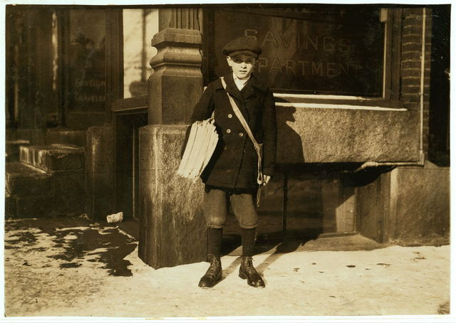 Alfred Hicks, a 10-year-old newsie, selling Boston papers at noon.  Location: Barre, Vermont / Lewis W. Hine.